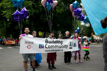 Pictur        06/14/14 Bi Brigade members holding our banner at Portland Pride 2014e