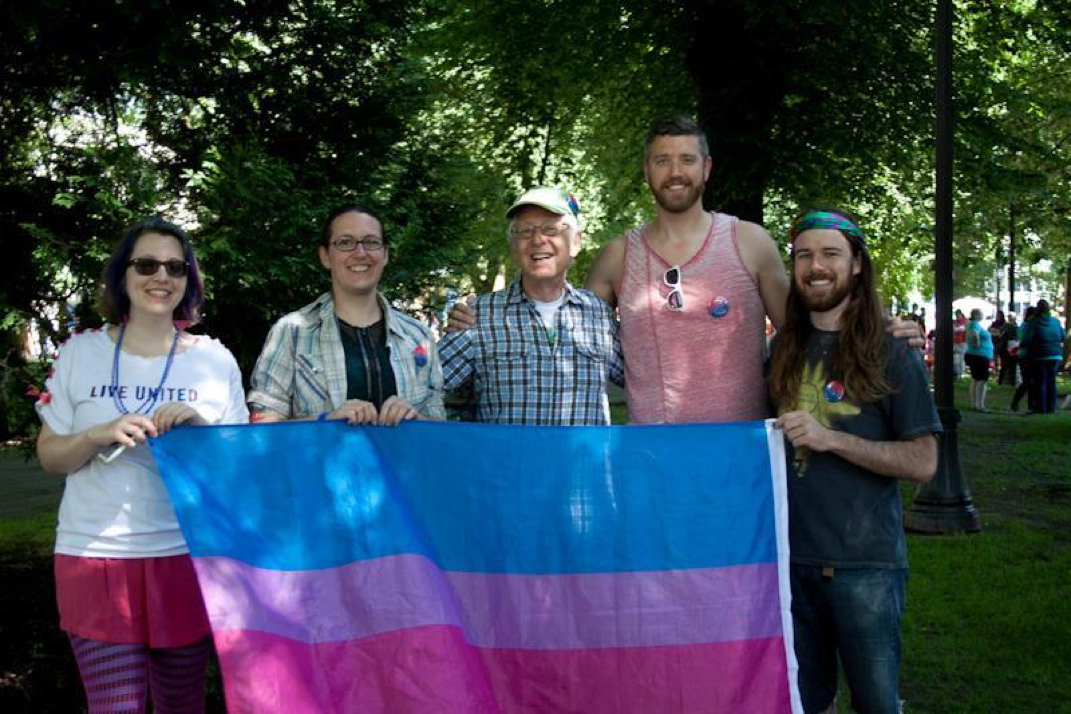 Picture        07/19/15 Bi Brigade members and the Bi Pride flag at Portland Pride 2015