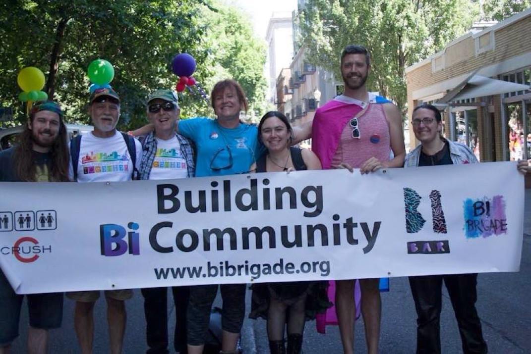 Picture        07/19/15 Bi Brigade members holding the Bi Brigade banner at Portland Pride 2015